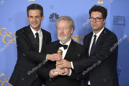 Stock Picture of (l-r) Simon Kinberg Ridley Scott and Michael Schaefer Hold the Award For Best Motion Picture - Musical Or Comedy For 'The Martian ' in the Press Room During 73rd Annual Golden Globe Awards at the Beverly Hilton Hotel in Beverly Hills California Usa 10 January 2016 United States Beverly Hills