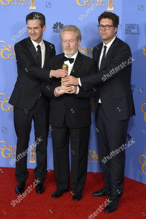 Us Director Ridley Scott (c) Uk Screenwriter Simon Winberg (l) and Producer Michael Schaefer (r) Hold the Award For Best Motion Picture - Musical Or Comedy For 'The Martian ' in the Press Room During 73rd Annual Golden Globe Awards at the Beverly Hilton Hotel in Beverly Hills California Usa 10 January 2016 United States Beverly Hills