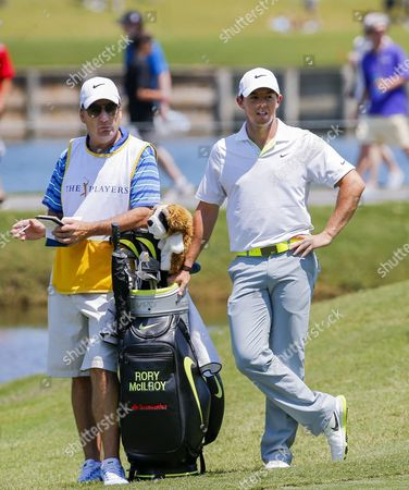 Rory Mcilroy (r) of Northern Ireland Stands with His Caddie J P Fitzgerald (l) on the Ninth Fairway During the Third Round of the Players Championship at the Tpc Sawgrass Stadium Course in Ponte Vedra Beach Florida Usa 09 May 2015 United States Ponte Vedra Beach