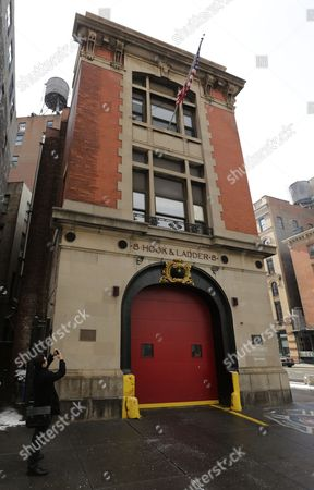 A Man Takes a Photograph of Ladder 8 Firehouse on the Corner of North Moore and Varick Street's in New York City Which was Used in the Comedy Classic 'Ghostbusters ' Co-written by the Late Harold Ramis in New York New York Usa 26 February 2014 Ramis Best-known As an Actor For 'Ghostbusters' 'Stripes' Writer/director For 'Caddyshack' and 'Groundhog Day' Died of Complications From Autoimmune Inflammatory Vasculitis a Rare Disease That Involves Swelling of the Blood Vessels on 24 February 2014 United States New York