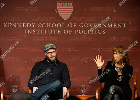 Stock Image of Canadian Actor Comedian and Filmmaker Seth Rogen (l) and Lizz Winstead Co-creator of the Daily Show (r) Participate in a Discussion on 'Politics and Humor' at the John F Kennedy School of Government at Harvard University in Cambridge Massachusetts Usa 02 December 2014 United States Cambridge