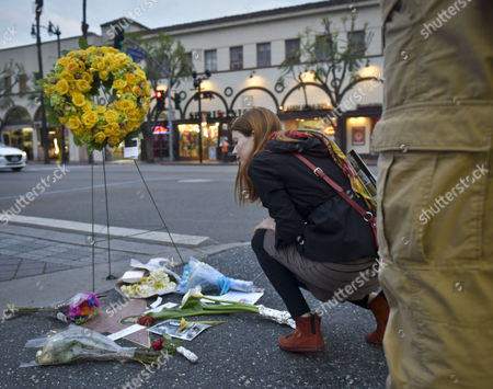 A Passer by Pays Their Respects to the Late Actor Leonard Nimoy at His Star on the Hollywood Walk of Fame in Hollywood California Usa 27 February 2015 After He Died Earlier That Day the 83-year-old who Became World Famous As One of the Lead Characters on the Starship Enterprise Movies Died at His Home in Los Angeles According to David Gersh Nimoy's Agent the Unflappable Spock a Fixture at the Side of Captain Kirk Along with the Other Members of the Crew of the Enterprise Wrote Television History with Its Racially Diverse Cast United States Hollywood