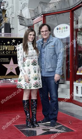 Costume Designer Courtney Hoffman (l) and Us Writer and Director Quentin Tarantino (r) Pose Next to Tarantino's Star on the Hollywood Walk of Fame During a Ceremony in Hollywood California Usa 21 December 2015 Tarantino Received the 2569th Star on the Walk of Fame in the Category of Motion Pictures United States Hollywood