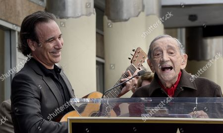 Us Film Producer Jack H Harris (r) Accompanied on Guitar by His Grandson Us Musician Jason Sinay (l) Sings a Song Duringthe Awarding Ceremony in Hollywood California Usa 04 February 2014 Harris was Awarded the 2 517th Star on the Hollywood Walk of Fame in the Category of Motion Pictures United States Hollywood