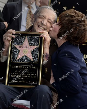 Stock Photo of Us Film Producer Jack H Harris (l) Gets a Kiss From Daughter Lynda Resnick (r)during the Awarding Ceremony in Hollywood California Usa 04 February 2014 Harris was Awarded the 2 517th Star on the Hollywood Walk of Fame in the Category of Motion Pictures United States Hollywood