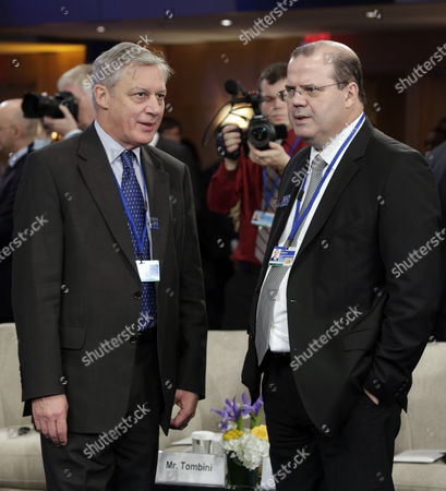 Christian Noyer Governor of the Central Bank of France (l) and Alexandre Tombini Governor of the Central Bank of Brazil (r) Chat Before the Start of a Meeting of the International Monetary and Financial Committee (imfc) During the International Monetary Fund (imf) World Bank Annual Meetings 2013 in Washington Dc Usa 12 October 2013 United States Washington