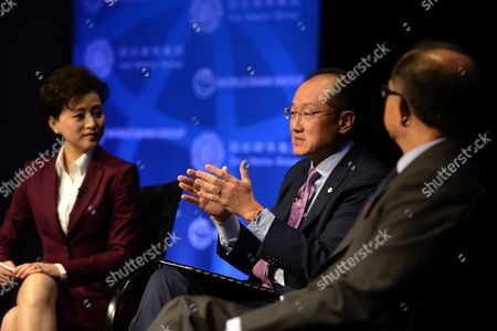 World Bank Group President Jim Yong Kim (c) with Chairman of the Sun Media Group and Sun Culture Foundation Yang Lan (l) and Senior Vice President and Chief Economist Kaushik Basu (r) Delivers Remarks at the 'Building Shared Prosperity in an Unequal World' Seminar During the International Monetary Fund and World Bank Group 2014 Annual Meetings in Washington Dc Usa 08 October 2014 the Meetings Run Through 12 October 2014 United States Washington