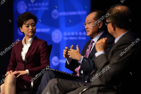 Stock Image of World Bank Group President Jim Yong Kim (c) with Chairman of the Sun Media Group and Sun Culture Foundation Yang Lan (l) and Senior Vice President and Chief Economist Kaushik Basu (r) Delivers Remarks at the 'Building Shared Prosperity in an Unequal World' Seminar During the International Monetary Fund and World Bank Group 2014 Annual Meetings in Washington Dc Usa 08 October 2014 the Meetings Run Through 12 October 2014 United States Washington