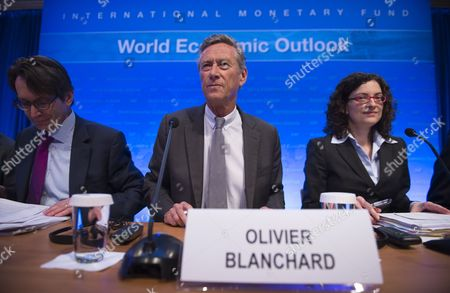 Imf Economic Counselor and Director of Research Department Olivier Blanchard (c) with Imf Researcher Thomas Helbling (l) and Imf Researcher Oya Celasun (r) Prepare For a News Conference on the World Economic Outlook During the 2015 International Monetary Fund (imf) and World Bank Group Spring Meetings in Washington Dc Usa 14 April 2015 the Meetings Run Through 19 April the Risks of Recession and Deflation in the Eurozone Have Decreased Imf Chief Economist Olivier Blanchard Said the Washington-based Crisis Lender Forecasts Eurozone Growth at 1 5 Per Cent This Year Up From 0 9 Per Cent in 2014 Lower Oil Prices and the European Central Bank's Quantitative Easing Programme Are Major Factors in the Region's Improved Outlook According to the Imf United States Washington