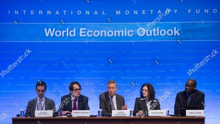Stock Photo of Imf Economic Counselor and Director of Research Department Olivier Blanchard (c) with Imf Researcher Gian Maria Milesi-ferretti (l) Imf Researcher Thomas Helbling (2-l) Imf Researcher Oya Celasun (2-r) and Imf Press Officer Ismila Dieng (r) at a News Conference on the World Economic Outlook During the 2015 International Monetary Fund (imf) and World Bank Group Spring Meetings in Washington Dc Usa 14 April 2015 the Meetings Run Through 19 April the Risks of Recession and Deflation in the Eurozone Have Decreased Imf Chief Economist Olivier Blanchard Said the Washington-based Crisis Lender Forecasts Eurozone Growth at 1 5 Per Cent This Year Up From 0 9 Per Cent in 2014 Lower Oil Prices and the European Central Bank's Quantitative Easing Programme Are Major Factors in the Region's Improved Outlook According to the Imf United States Washington