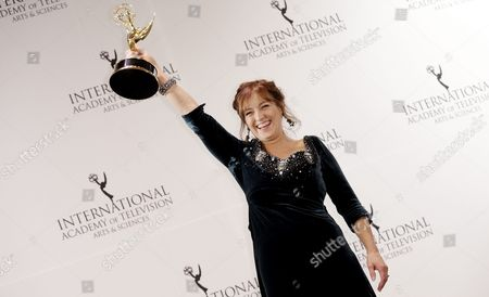 Stock Picture of Actress Anneke Von Der Lippe of Norway Poses with the International Emmy Award in the 'Best Performance by an Actress' Category For 'Oyevitne' During the 43rd International Emmy Awards Gala in New York New York Usa 23 November 2015 United States New York