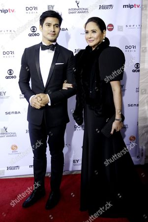 Actor Piolo Pascual (l) of the Philippines and Charo Santos Concio (r) President of the International Academy of Television Arts and Sciences Arrive For the 43rd International Emmy Awards Gala in New York New York Usa 23 November 2015 United States New York