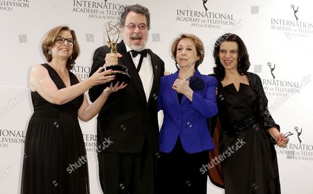 (l-r) Ana Luiza Azevedo Producer Jorge Furtado Actress Fernanda Montenegro and Producer Nora Goulart Pose in the Press Room with the International Emmy Award in the 'Comedy' Category For 'Doce De Mae' During the 43rd International Emmy Awards Gala in New York New York Usa 23 November 2015 United States New York