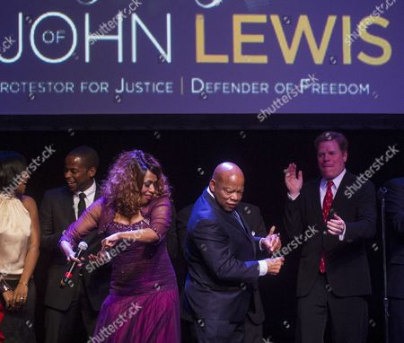 Democrat Congressman John Lewis (c-r) Dances with Us Singer Jennifer Holliday During a Gala Celebrating His 75th Birthday Held at the Tabernacle in Atlanta Georgia Usa 28 March 2015 Lewis Has Devoted Much of His Life to Civil Rights Activism Coming to the Forefront 50 Years Ago This Month when Armed Policemen Attacked He and Other Peaceful Demonstrators Attempting to March Across the Edmund Pettus Bridge in Selma Alabama an Incident That Became Known As Bloody Sunday United States Atlanta