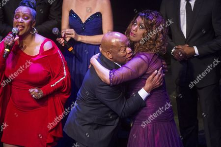 Us Singer Jennifer Holliday (r) Reacts As Democrat Congressman John Lewis (c) Gives Her a Hug During a Gala Celebrating His 75th Birthday Held at the Tabernacle in Atlanta Georgia Usa 28 March 2015 Lewis Has Devoted Much of His Life to Civil Rights Activism Coming to the Forefront 50 Years Ago This Month when Armed Policemen Attacked He and Other Peaceful Demonstrators Attempting to March Across the Edmund Pettus Bridge in Selma Alabama an Incident That Became Known As Bloody Sunday United States Atlanta