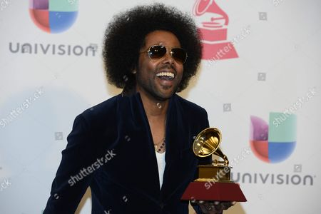 Alex Cuba with His Award For 'Best Singer-songwriter Album' in the Press Room at the 16th Annual Latin Grammy Awards at the Mgm Grand in Las Vegas Nevada Usa 19 November 2015 Latin Grammy Awards Recognize Artistic And/or Technical Achievement not Sales Figures Or Chart Positions and the Winners Are Determined by the Votes of Their Peers-the Qualified Voting Members of the Academy United States Las Vegas