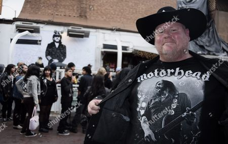Fan of British Metal Band Motorhead David Acton Sports a Motorhead T-shirt As People Gathered to Mourn Lead Singer Lemmy at the Rainbow Bar and Grill in Hollywood California Usa 09 January 2016 the Rainbow Purportedly Lemmy's Favorite Bar Allowed Fans to Come in and Celebrate the Rocker's Life Ian Fraser Kilmister Known As Lemmy Died on 28 December 2015 Aged 70 United States Hollywood