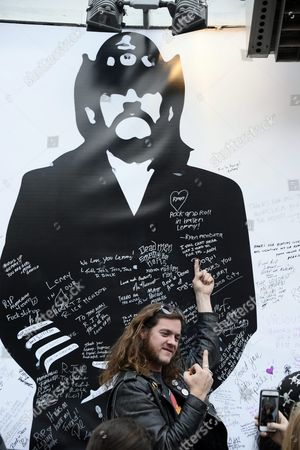 A Fan of British Metal Band Motorhead Lead Singer Lemmy Poses For a Picture with a Giant Memorial at the Rainbow Bar and Grill in Hollywood California Usa 09 January 2016 the Rainbow Purportedly Lemmy's Favorite Bar Allowed Fans to Come in and Celebrate the Rocker's Life United States Hollywood