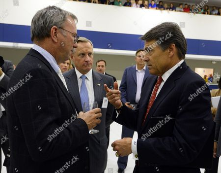Google Executive Chairman Eric Schmidt (l) Talks with Texas Governor Rick Perry (r) and Chairman of the Board of It Company Perot Systems Ross Perot Jr (c) at the Opening of the New Motorola Flextronics Factory in Fort Worth Texas Usa 10 September 2013 the New Moto X Smartphone Will Be Assembled at the Factory in Fort Worth Texas United States Fort Worth