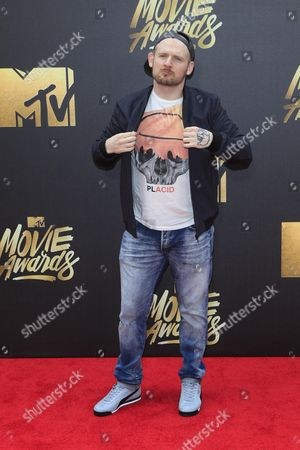 Stock Image of Mac Lethal Arrives For the 2016 Mtv Movie Awards at the Warner Brothers Studios in Burbank California Usa 09 April 2016 the Movies Are Nominated by Producers and Executives From Mtv and the Winners Are Chosen Online by the General Public United States Burbank
