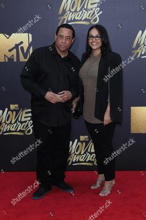 Stock Photo of N W A's Dj Yella (l) and Tomica Woods-wright (r) Arrive For the 2016 Mtv Movie Awards at the Warner Brothers Studios in Burbank California Usa 09 April 2016 the Movies Are Nominated by Producers and Executives From Mtv and the Winners Are Chosen Online by the General Public United States Burbank