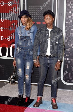Musician Pharrell Williams (r) and Helen Lasichanh (l) Arrive on the Red Carpet For the 32nd Mtv Video Music Awards at the Microsoft Theater in Los Angeles California Usa 30 August 2015 United States Los Angeles