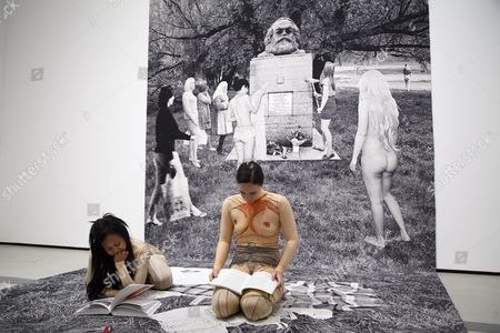 Performance Artists Read Books Under the Installation 'Death of Marxism Women of All Lands Unite' by Artist Goshka Macuga at the Press Preview of the New 'The Broad' Contemporary Art Museum in Los Angeles California Usa 16 September 2015 the Museum Built by Local Philanthropists Eli and Edythe Broad Houses Nearly 2 000 Works From One of the Most Prominent Collections of Contemporary Art in the World United States Los Angeles