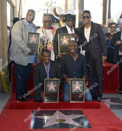 Us Musical Group Kool & the Gang and Producer Vincent Herbert (l) and Us Singer Jermaine Jackson (r) Pose with Them on Their Star After Being Honored on the Hollywood Walk of Fame in Hollywood California Usa 08 October 2015 Kool & the Gang with Such Hits As 'Celebration' and 'Get Down on It' Received the 2 560th Recording Artist Star on the Famous Boulevard From L to R: Standing Herbert Dennis 'Dt' Thomas Ronald Khalis Bell and Jackson From L to R Sitting: Robert 'Kool' Bell and George Brown United States Hollywood