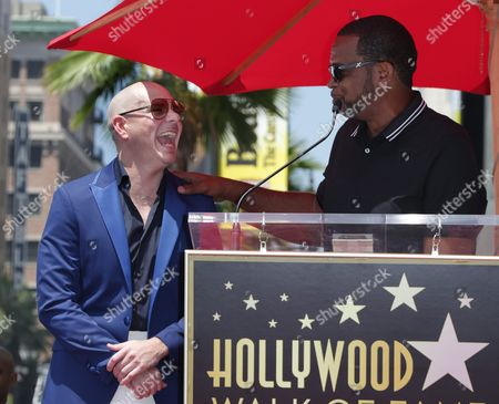 Us Rapper Luther Campbell (r) Introduces Cuban-american Singer Pitbull (l) During a Ceremony Honoring Him with a Star on the Hollywood Walk of Fame in Hollywood California Usa 15 July 2016 Pitbull Received the 2 584th Star in the Recording Category United States Hollywood