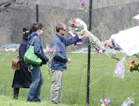 Fans and Mourners Place Flowers on a Fence Outside of Paisley Park the Home and Studio of Us Musician Prince in Chanhassen Minnesota Usa 21 April 2016 American Singer-songwriter and Musician Prince a Multi-talented Artist who Produced a String of Genre-fusing Hits in the 1980s Died on 21 April at His Residence in Chanhassen Minnesota He was 57 'It is with Profound Sadness That i Am Confirming That the Legendary Iconic Performer Prince Rogers Nelson Has Died at His Paisley Park Residence This Morning ' the Artist's Publicist Yvette Noel-schure Said in a Brief Statement That Did not Indicate the Cause of Death Sources Close to the Artist Said That He Had Been Suffering From a Bout of the Flu For Several Weeks United States Minneapolis