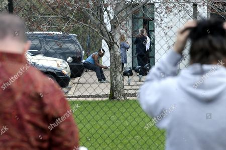 Stock Photo of Fans and Mourners Watch As Police and Employees Gather Outside of Paisley Park the Home and Studio of Us Musician Prince in Chanhassen Minnesota Usa 21 April 2016 American Singer-songwriter and Musician Prince a Multi-talented Artist who Produced a String of Genre-fusing Hits in the 1980s Died on 21 April at His Residence in Chanhassen Minnesota He was 57 'It is with Profound Sadness That i Am Confirming That the Legendary Iconic Performer Prince Rogers Nelson Has Died at His Paisley Park Residence This Morning ' the Artist's Publicist Yvette Noel-schure Said in a Brief Statement That Did not Indicate the Cause of Death Sources Close to the Artist Said That He Had Been Suffering From a Bout of the Flu For Several Weeks United States Minneapolis