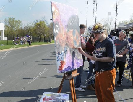 Stock Image of Dan Lacey of Elko Minnesota Paints a Tribute to Prince Outside of Paisley Park the Home and Studio of Us Musician Prince in Chanhassen Minnesota Usa 21 April 2016 American Singer-songwriter and Musician Prince a Multi-talented Artist who Produced a String of Genre-fusing Hits in the 1980s Died on 21 April at His Residence in Chanhassen Minnesota He was 57 'It is with Profound Sadness That i Am Confirming That the Legendary Iconic Performer Prince Rogers Nelson Has Died at His Paisley Park Residence This Morning ' the Artist's Publicist Yvette Noel-schure Said in a Brief Statement That Did not Indicate the Cause of Death Sources Close to the Artist Said That He Had Been Suffering From a Bout of the Flu For Several Weeks United States Minneapolis