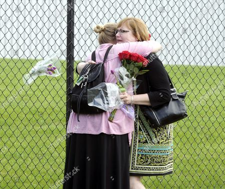 Chris Prather (l) of Brooklyn Park Minnesota and Debra Harper (r) of Minneapolis Comfort Each Other Outside of Paisley Park the Home and Studio of Us Musician Prince in Chanhassen Minnesota Usa 21 April 2016 American Singer-songwriter and Musician Prince a Multi-talented Artist who Produced a String of Genre-fusing Hits in the 1980s Died on 21 April at His Residence in Chanhassen Minnesota He was 57 'It is with Profound Sadness That i Am Confirming That the Legendary Iconic Performer Prince Rogers Nelson Has Died at His Paisley Park Residence This Morning ' the Artist's Publicist Yvette Noel-schure Said in a Brief Statement That Did not Indicate the Cause of Death Sources Close to the Artist Said That He Had Been Suffering From a Bout of the Flu For Several Weeks United States Minneapolis
