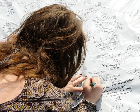 Fans Sign a Banner As They Gather Outside of Paisley Park the Home and Studio of Us Musician Prince in Chanhassen Minnesota Usa 21 April 2016 American Singer-songwriter and Musician Prince a Multi-talented Artist who Produced a String of Genre-fusing Hits in the 1980s Died on 21 April at His Residence in Chanhassen Minnesota He was 57 'It is with Profound Sadness That i Am Confirming That the Legendary Iconic Performer Prince Rogers Nelson Has Died at His Paisley Park Residence This Morning ' the Artist's Publicist Yvette Noel-schure Said in a Brief Statement That Did not Indicate the Cause of Death Sources Close to the Artist Said That He Had Been Suffering From a Bout of the Flu For Several Weeks United States Minneapolis