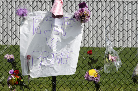 Stock Image of Fans and Mourners Place Flowers and a Sign on a Fence Outside of Paisley Park the Home and Studio of Us Musician Prince in Chanhassen Minnesota Usa 21 April 2016 American Singer-songwriter and Musician Prince a Multi-talented Artist who Produced a String of Genre-fusing Hits in the 1980s Died on 21 April at His Residence in Chanhassen Minnesota He was 57 'It is with Profound Sadness That i Am Confirming That the Legendary Iconic Performer Prince Rogers Nelson Has Died at His Paisley Park Residence This Morning ' the Artist's Publicist Yvette Noel-schure Said in a Brief Statement That Did not Indicate the Cause of Death Sources Close to the Artist Said That He Had Been Suffering From a Bout of the Flu For Several Weeks United States Minneapolis