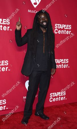 Ghanaian Singer Rocky Dawuni Arrives For the 2016 Musicares Person of the Year Benefit Gala Dinner and Concert in Los Angeles California Usa 13 February 2016 the Award is Presented Annually by the National Academy of Recording Arts and Sciences During Grammy Week in Support of the Musicares Foundation Non-profit Organization United States Los Angeles