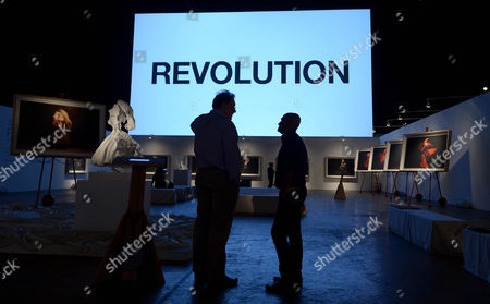 People Stand Inside the Installation Titled 'Revolution' by Artist Steven Sebring at the 69th Regiment Armory in New York New York Usa 22 May 2013 the Installation Which Runs Until 23 May 2013 Features Photographs Video Work and Sculptures That Explore Moving Forms and Concepts of Time United States New York