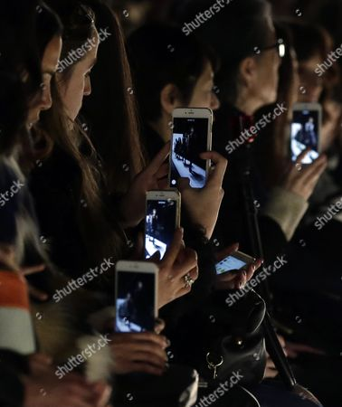 Guests with Their Cellphones Take Pictures of Models Presenting Creations From the Fall 2016 Collection of Herve Leger by Max Azria During the New York Fall Fashion Week in New York New York Usa 13 February 2016 the Fall 2016 Collections Are Presented From 11 to 18 February United States New York