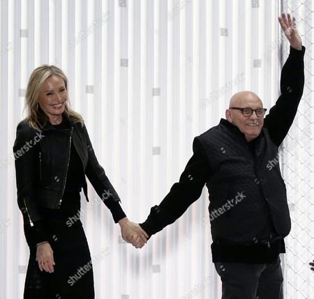 Stock Image of Us Fashion Designers Max Azria (r) and His Wife Lubov Azria Appear on the Catwalk at the Conclusion of the Presentation of Their the Fall 2016 Collection For Herve Leger by Max Azria During the New York Fall Fashion Week in New York New York Usa 13 February 2016 the Fall 2016 Collections Are Presented From 11 to 18 February United States New York