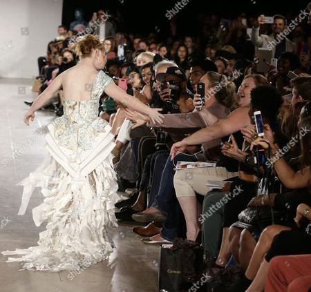 Australian Model Madeline Stuart who Has Down's Syndrome Receives High-fives From Spectators As She Walks on the Runway During the Spring 2016 Collection by Ftl Moda Show During New York Fashion Week in New York New York Usa 13 September 2015 the Spring 2016 Collections Are Presented From 10 to 17 September United States New York