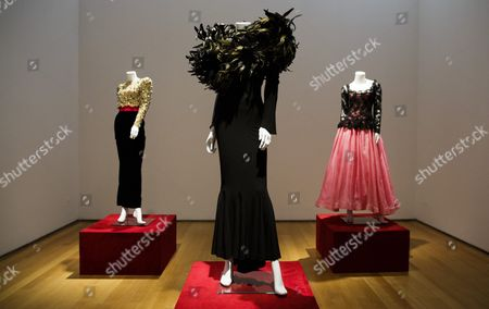 A View of Three Dresses Owned by the Late Joan Rivers on Display During a Preview of an Auction of the Actress' Personal Items at Christie's in New York New York Usa 17 June 2016 the Auction Which Includes Furniture Clothing Art and Jewelry From Rivers' New York Apartment is Being Held Online Until 23 June 2016 with a Live Portion Taking Place on 22 June 2016 United States New York