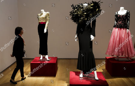 Stock Picture of A View of Three Dresses Owned by the Late Joan Rivers on Display During a Preview of an Auction of the Actress' Personal Items at Christie's in New York New York Usa 17 June 2016 the Auction Which Includes Furniture Clothing Art and Jewelry From Rivers' New York Apartment is Being Held Online Until 23 June 2016 with a Live Portion Taking Place on 22 June 2016 United States New York