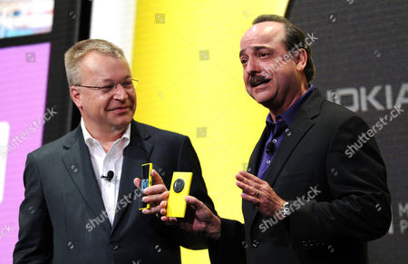 Stephen Elop (l) Chief Executive Officer of Nokia Corporation Stands with Ralph De La Vega President and Ceo of At&t Mobility During the Introduction of the New Nokia Lumia 1020 Smartphone with a 41 Megapixel Camera at a Press Conference in New York New York Usa 11 July 2013 the New Phone is Built Around Highly Advanced Camera United States New York