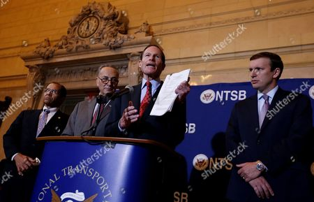 Us Senator Richard Blumenthal (2-r)(connecticut) Holds Up a Report on Probable Causes of Five Accident Investigations Involving Metro North Railroad During a Press Conference with Christopher Hart (l) Acting Chairman of the National Transportation Safety Board Us Senator Charles E Schumer (new York) (2-l) and Christopher Murphy (connecticut) (r) at Grand Central Station in New York New York Usa 28 October 2014 the Accidents Discussed in the Report Occurred Over a 10-month Period Between May 2013 and March 2014 and Killed an Injured a Number of People United States New York