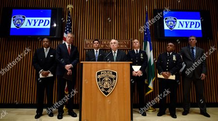 New York City Police Commissioner William J Bratton (c) Talks As New York City Mayor Bill De Blasio (2-l) Nypd Chief of Manhattan Detectives William Aubry (3-l) Nypd Chief of Department James P O'neill (3-r) and Other Police Department Representatives Listen During a Press Conference About Last Night's Shooting Death of New York City Police Officer Randolph Holder in New York New York Usa on 21 October 2015 Holder was Shot in the Harlem Neighborhood of New York on Tuesday Night and Suspect in the Case Tyrone Howard Has Been Arrested United States New York