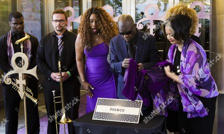 Musicians Mel'sa Morgan (3-l) Maceo Parker (4-l) Jonelle Procope (r) the Ceo of the Apollo Theater and Members of Prince's New Power Generation (l) Unveil a Plaque For the Late Musician Prince For the Apollo Theater's Walk of Fame in New York New York Usa 13 June 2016 Prince Died on 21 April 2016 Due to a Overdose of a Prescription Medication United States New York