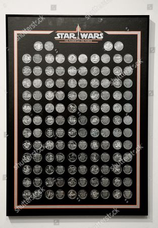 Stock Photo of A Close-uo View of a Star Wars Coin Collection From 1985 Estimated to Sell For 25 000 - 135 000 Us Dollars During a Preview of an Auction of Items Associated with the Star Wars Films at Sotheby's in New York New York Usa 02 December 2015 the Auction Which is Being Held Online on 11 December Features a Number of Rare and Valuable Star Wars Collectables Which Are All From the Collection of the Japanese Designer Nigo United States New York