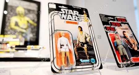 A View of a Display of Star Wars Memorabilia Including an Action Figure of Luke Skywalker From 1978 Estimated to Sell For 12 000 18 000 Us Dollars During a Preview of an Auction of Items Associated with the Star Wars Films at Sotheby's in New York New York Usa 02 December 2015 the Auction Which is Being Held Online on 11 December Features a Number of Rare and Valuable Star Wars Collectables Which Are All From the Collection of the Japanese Designer Nigo United States New York