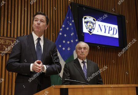 Stock Photo of Fbi Director James Comey (l) Speaks to Reporters After Addressing the Nypd Shield Security Conference As New York City Police Commissioner William J Bratton (r) Looks on at Police Headquarters in New York New York Usa 16 December 2015 Shield is an Umbrella Program For a Series of Police Initiatives Relating to Private Sector Security and Counterterrorism United States New York