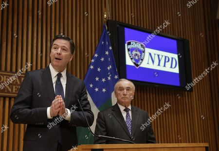 Fbi Director James Comey (l) Speaks to Reporters After Addressing the Nypd Shield Security Conference As New York City Police Commissioner William J Bratton (r) Looks on at Police Headquarters in New York New York Usa 16 December 2015 Shield is an Umbrella Program For a Series of Police Initiatives Relating to Private Sector Security and Counterterrorism United States New York